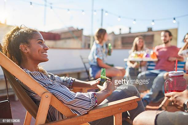 Young beautiful woman enjoying at a roofparty.
