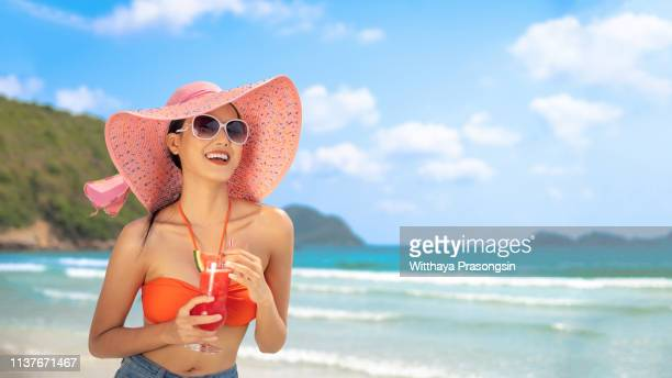 young beautiful woman enjoying summer vacation, beach relax, summer in tropics - margarita beach stock photos and pictures