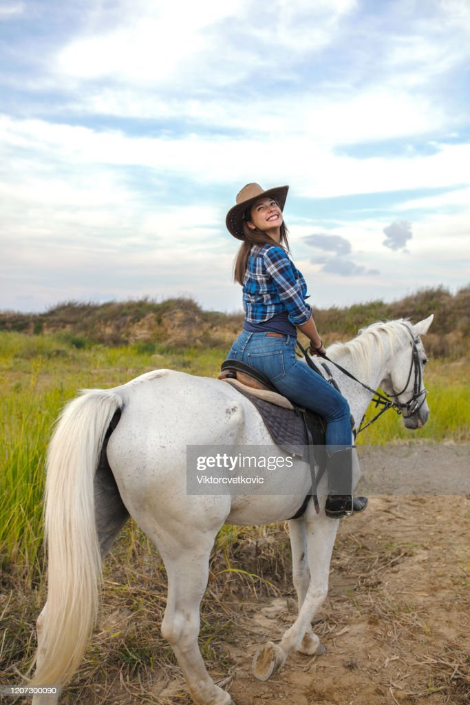 Young Beautiful Woman Enjoys Riding Horses In Nature High Res Stock Photo Getty Images