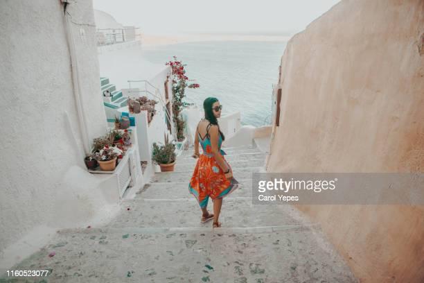 young beautiful woman exploring santorini,greece - greece tourism stock pictures, royalty-free photos & images