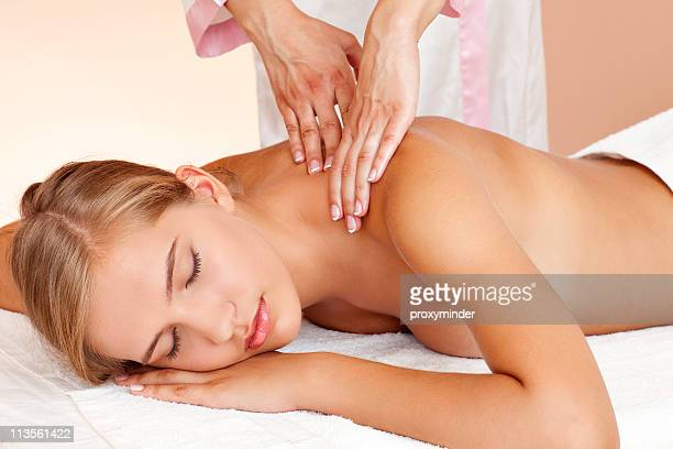 young beautiful woman having body treatment - body massage stock photos and pictures