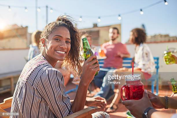 Young beautiful woman having fun at a roofparty.