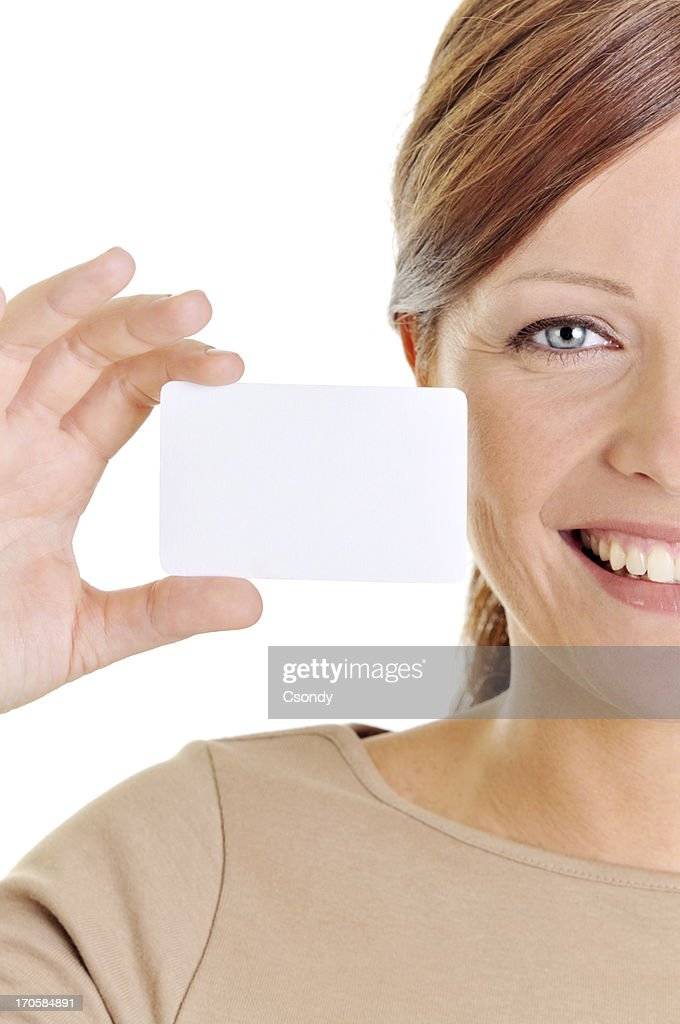 Young beautiful woman holding a business card : Stock Photo