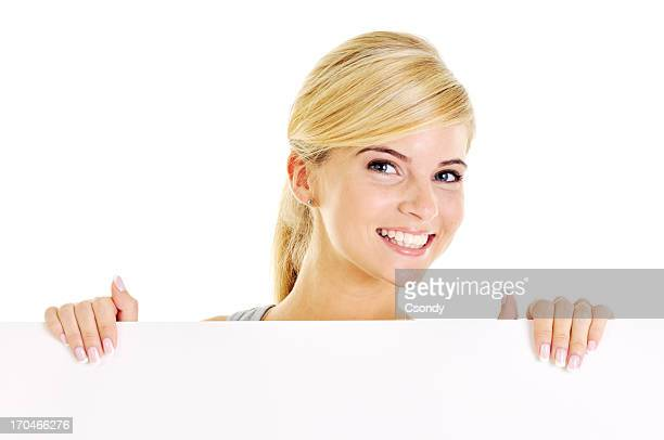 Young beautiful woman holding a white board