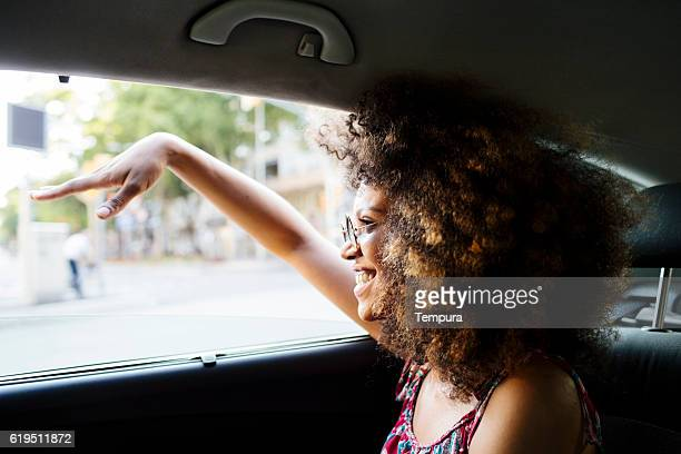 Young beautiful woman in a cab.