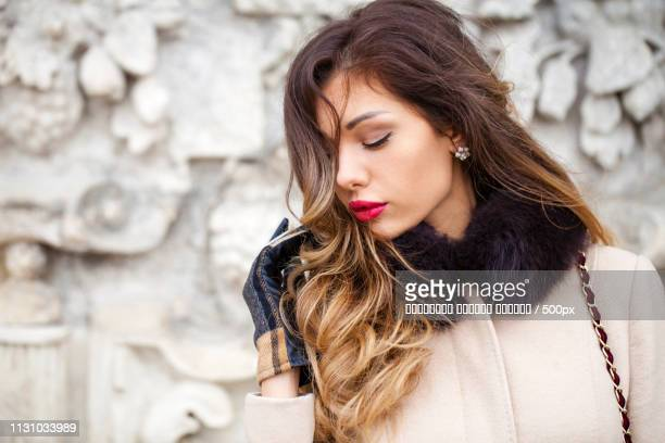 Young Beautiful Woman In Beige Coat