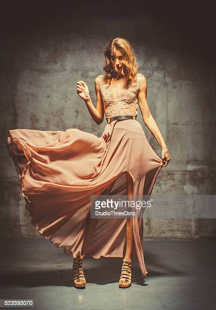 young beautiful woman in evening dress - evening gown stock photos and pictures