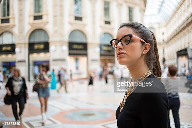 Young beautiful woman in Galleria Vittorio Emanuele, Milan