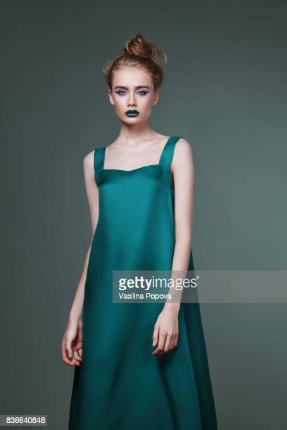 young beautiful woman in green dress - green dress stock pictures, royalty-free photos & images
