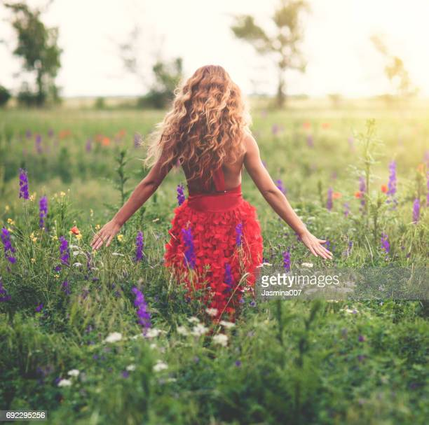 Young beautiful woman in poppy field