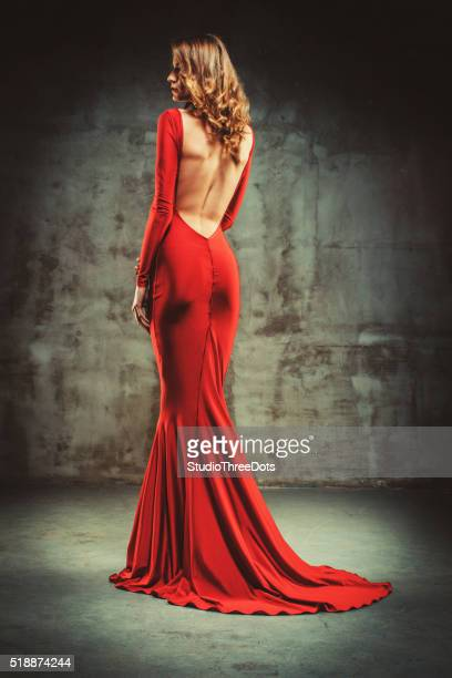 young beautiful woman in red dress - evening gown stock photos and pictures