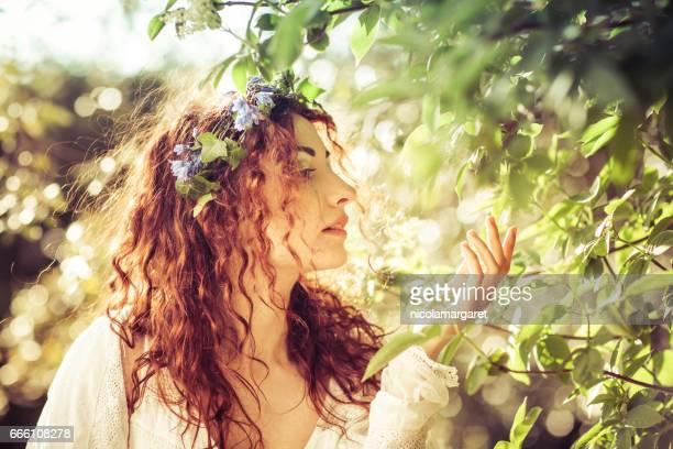 Young beautiful woman in sunshine