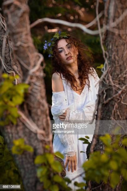 Young beautiful woman in the woods