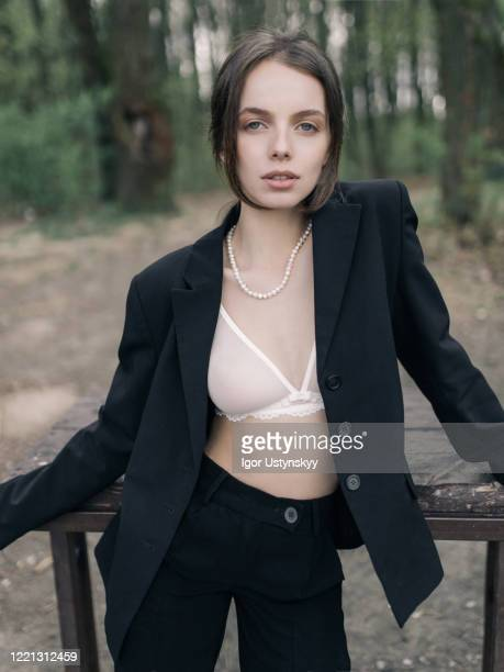 young beautiful woman in underwear and jacket - gender role stock pictures, royalty-free photos & images