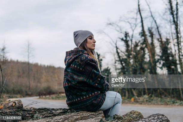 Young beautiful woman inside the forest