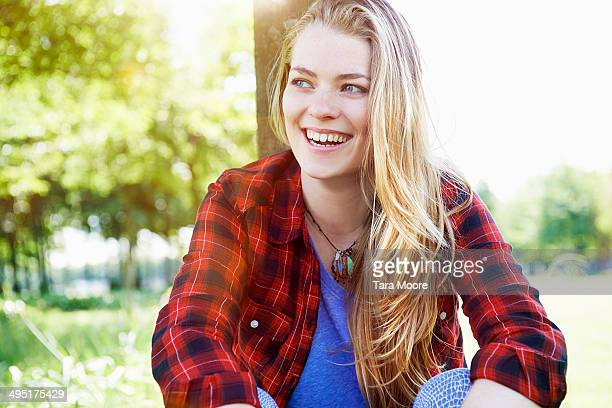 young beautiful woman laughing in park