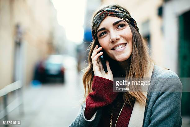 Young beautiful woman making a phone call.
