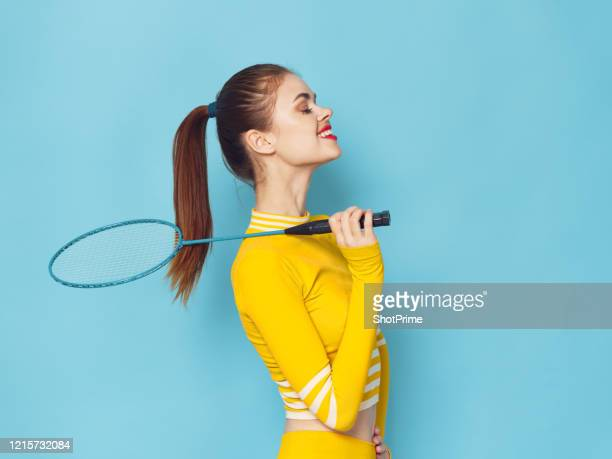 a young beautiful woman of athletic appearance leads a sporty lifestyle and plays badminton. - world sports championship stock pictures, royalty-free photos & images