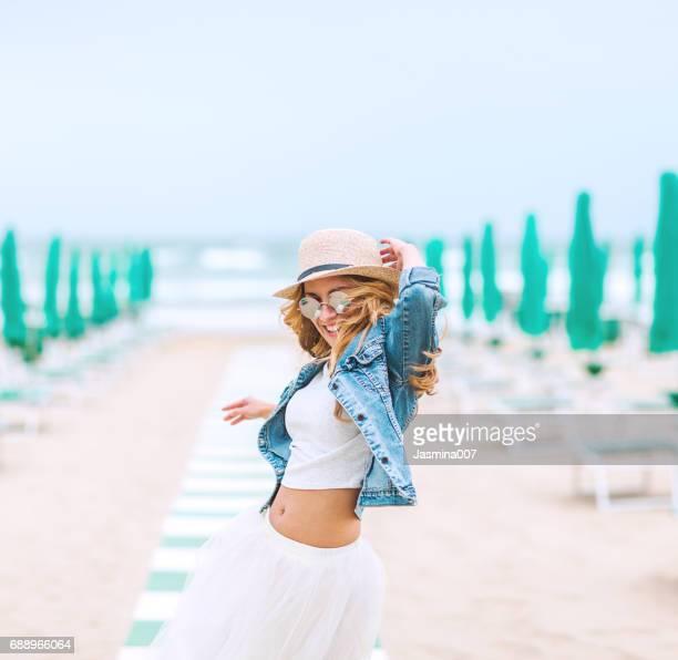 young beautiful woman on beach - tulle netting stock pictures, royalty-free photos & images