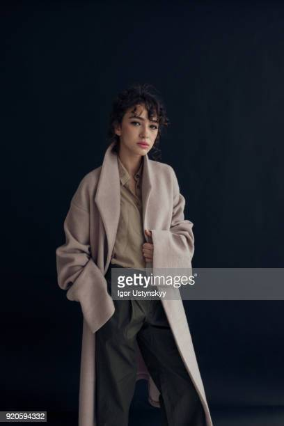 young beautiful woman on dark background - coat ストックフォトと画像