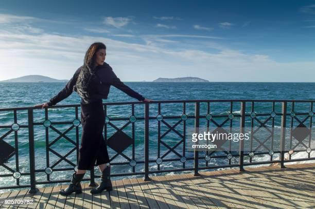 Young beautiful woman on the bridge