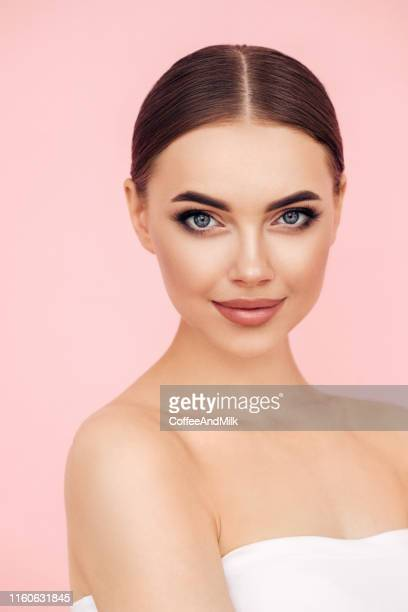 young beautiful woman - pink background stock pictures, royalty-free photos & images