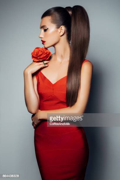 young beautiful woman - red roses stock photos and pictures