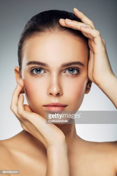 young beautiful woman - beauty treatment stock pictures, royalty-free photos & images