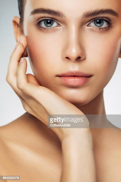 young beautiful woman - skin care stock pictures, royalty-free photos & images