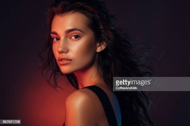 young beautiful woman - lighting equipment stock pictures, royalty-free photos & images
