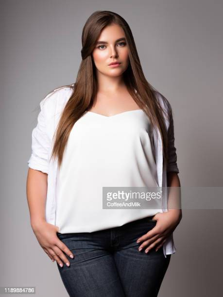 young beautiful woman. plus size model - chubby stock pictures, royalty-free photos & images