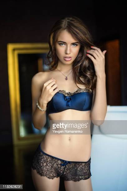 young beautiful woman posing in expensive lace lingerie - seductive stock photos and pictures