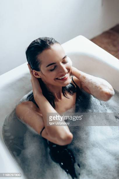 young beautiful woman relaxing in bubble bath - taking a bath stock pictures, royalty-free photos & images