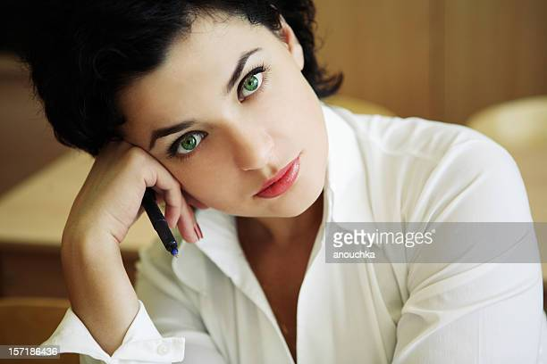 young beautiful woman sitting in school classroom, portrait - green eyes stock pictures, royalty-free photos & images