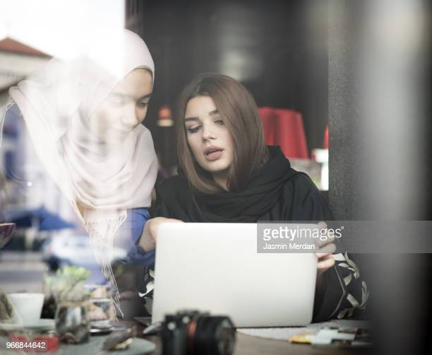 Young beautiful woman using laptop in hotel