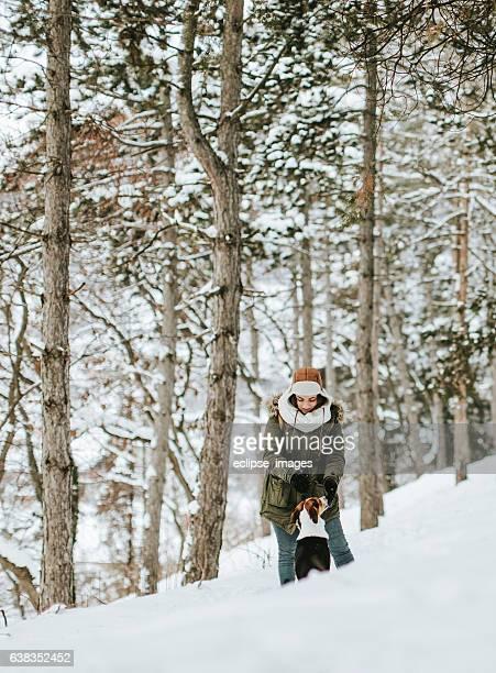 Young beautiful woman walking in winter park smiling