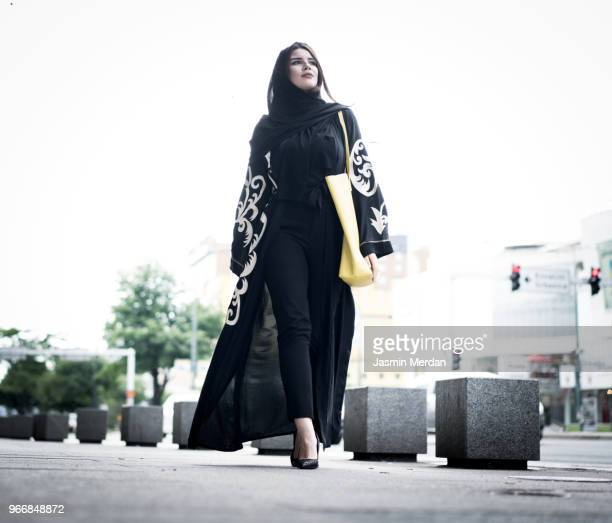 young beautiful woman walking on the street - one young woman only stock pictures, royalty-free photos & images