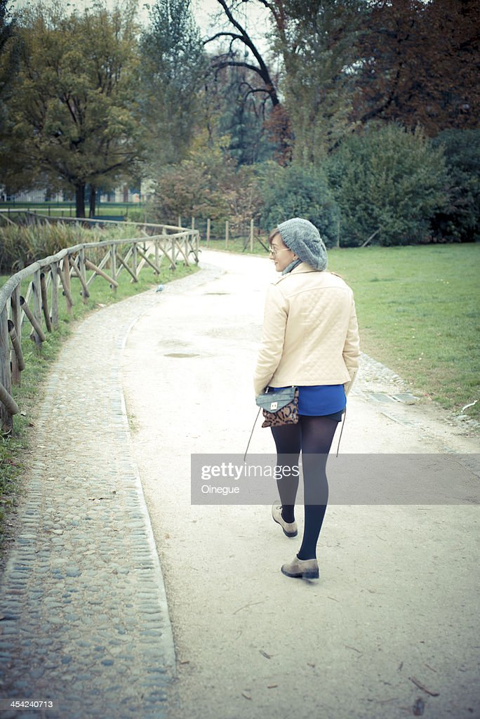 young beautiful woman walking : Stock Photo