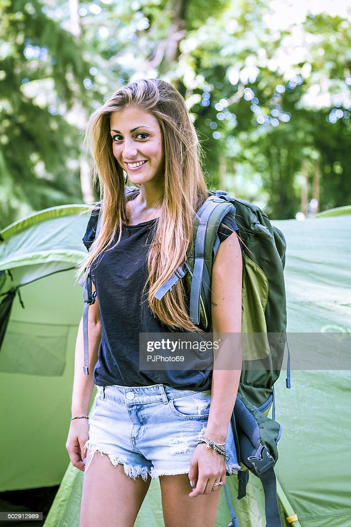Young beautiful woman with backpak : Stock Photo