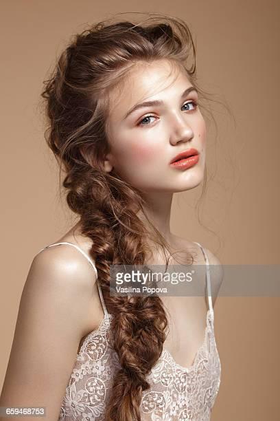 young beautiful woman with braid - cheveux tressés photos et images de collection