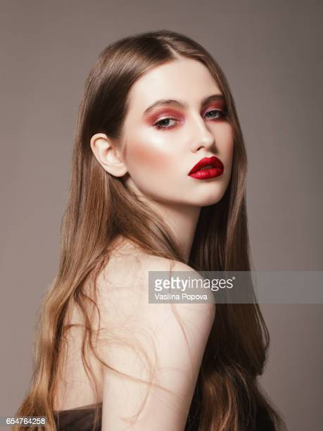 Young beautiful woman with bright make-up