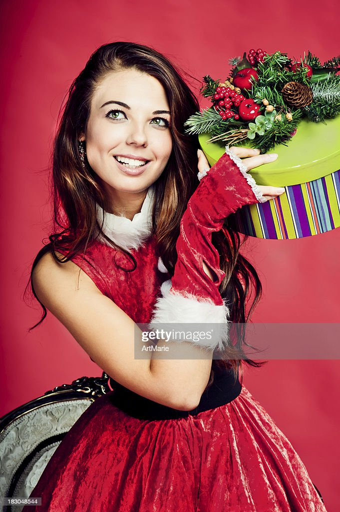 Young beautiful woman with Christmas present : Stock Photo