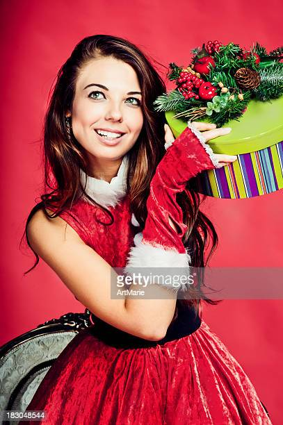 Young beautiful woman with Christmas present