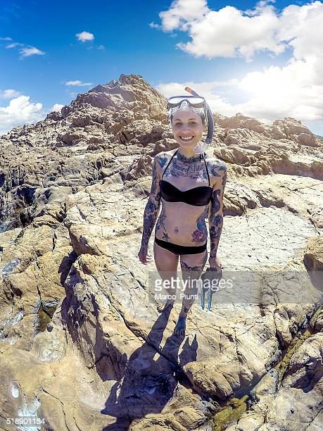 Young beautiful woman with diving mask smiling