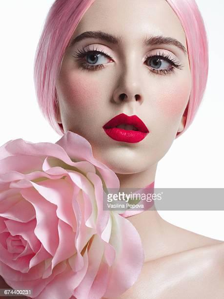 Young beautiful woman with flower choker