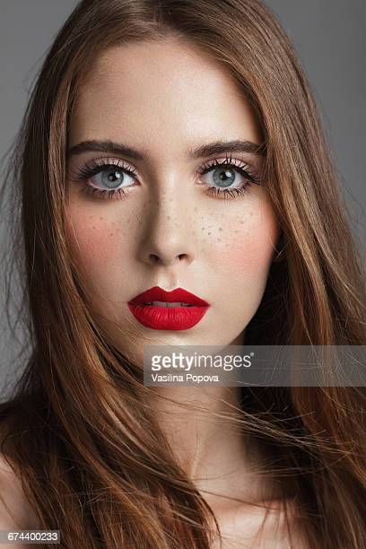 Young beautiful woman with freckles