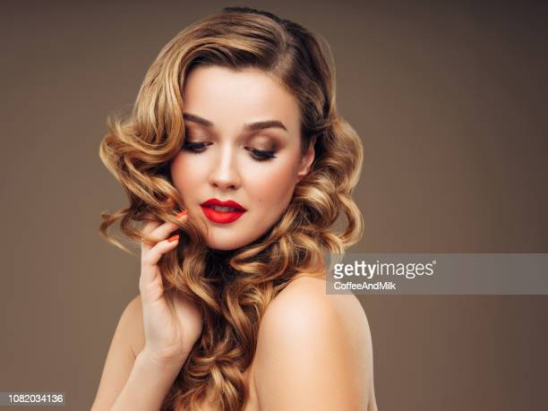 young beautiful woman with long and wavy hair - beauty treatment stock pictures, royalty-free photos & images