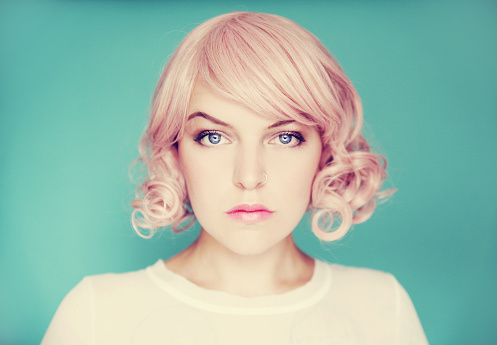 Young beautiful woman with pink curly hair - gettyimageskorea