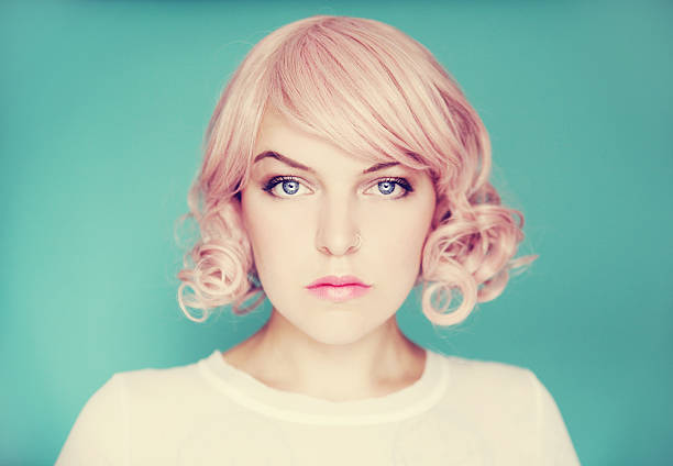 Young beautiful woman with pink curly hair