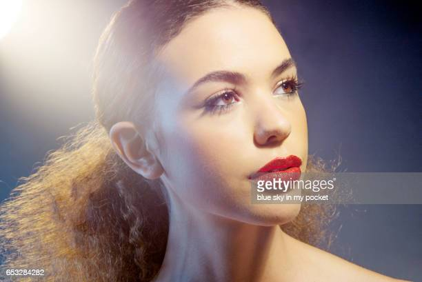 a young beautiful woman with red glittery lips - mascara stock pictures, royalty-free photos & images